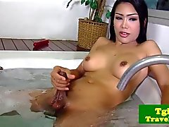 Busty ladyboy jerking cock in bathtub