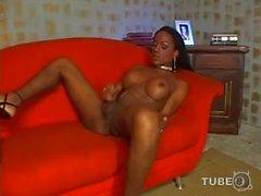 Hot latina tranny fucks on red sofa