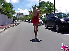 Ana Mancinis short sexy red dress outdoors