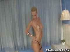 Skinny tall shemale with tan lined tits is jerking off