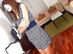 Ladyboy cutie plays with herself at work